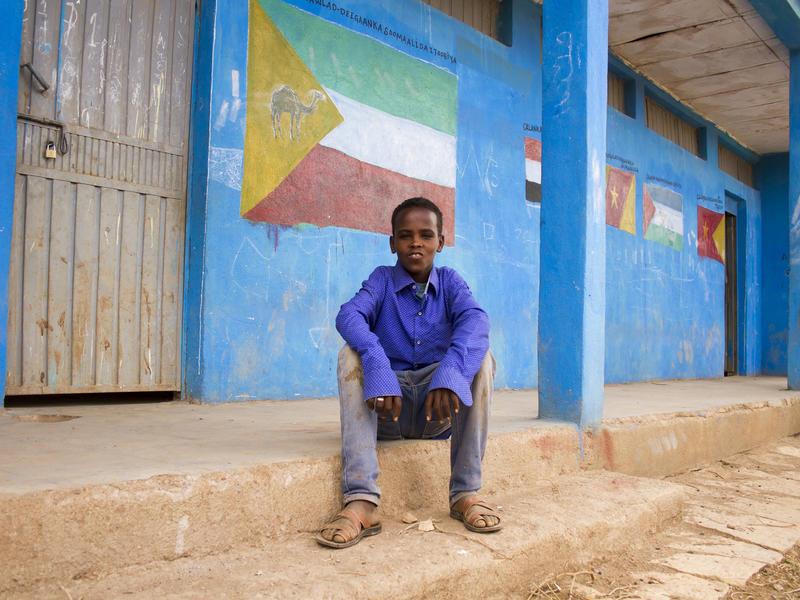 Abdil outside school