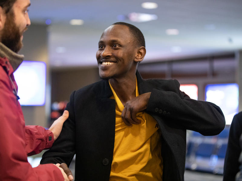 Divin, 28, a refugee from the Democratic Republic of Congo, waits for his in-laws to arrive at Boise Airport.