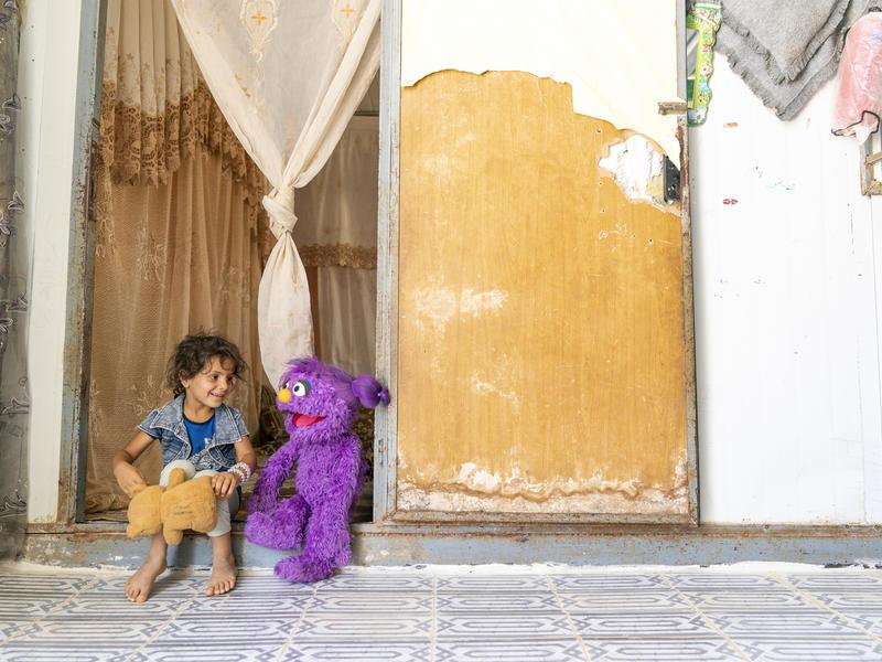 """Ahlan Simsim"" new Muppet Basma with a child in Jordan"