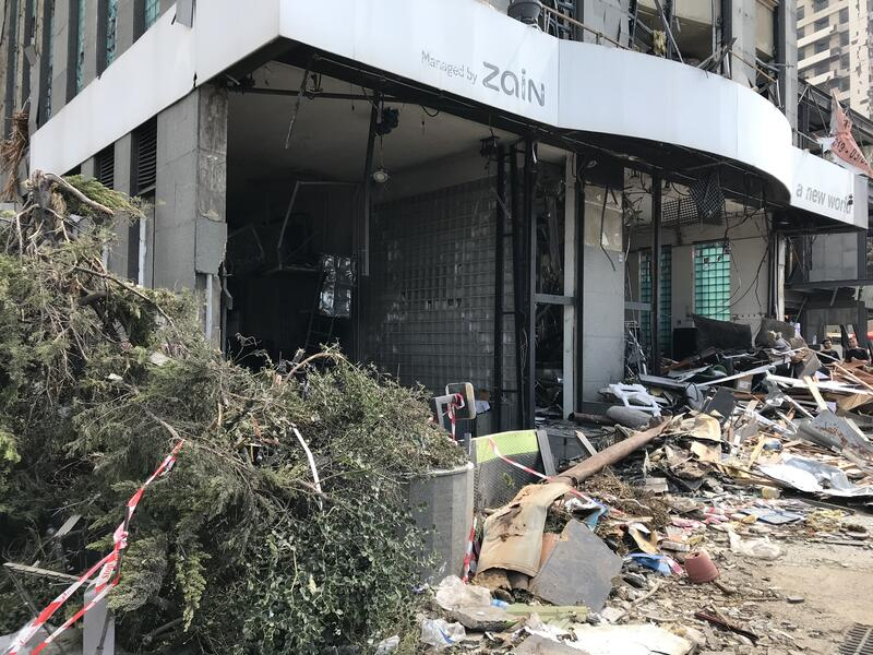 Street-level view of debris and damage to a building in Beirut, Lebanon after the August 4, 2020 explosion