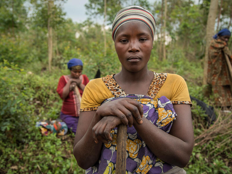 Women with farming implements work the land in the Democratic Republic of Congo.