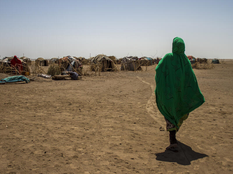 Sada Mohammed, 30, walks back to her shelter over parched earth after being displaced by a drought in Ethiopia in 2016.