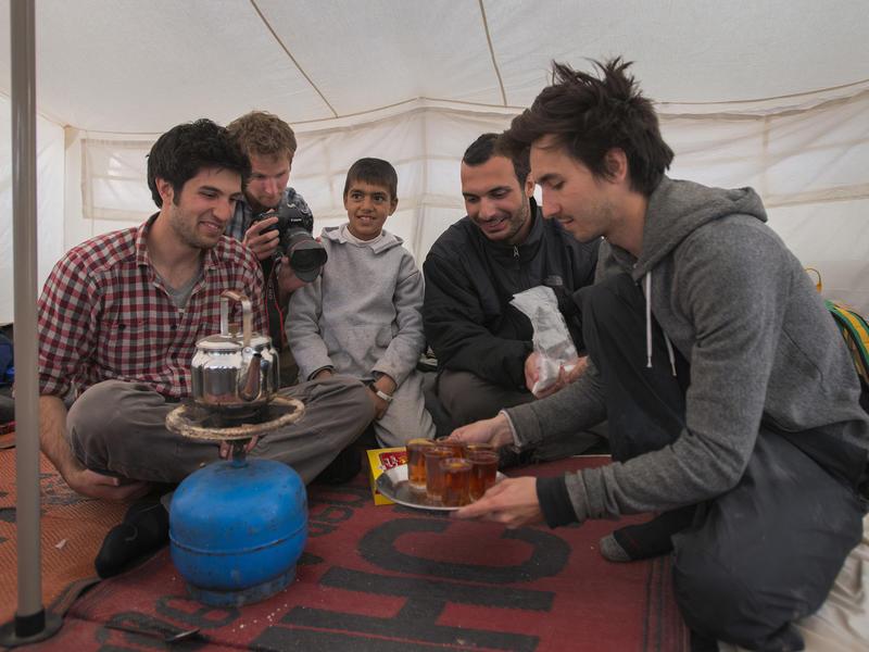 IRC Salam Neighbor team in tent in Zaatari camp