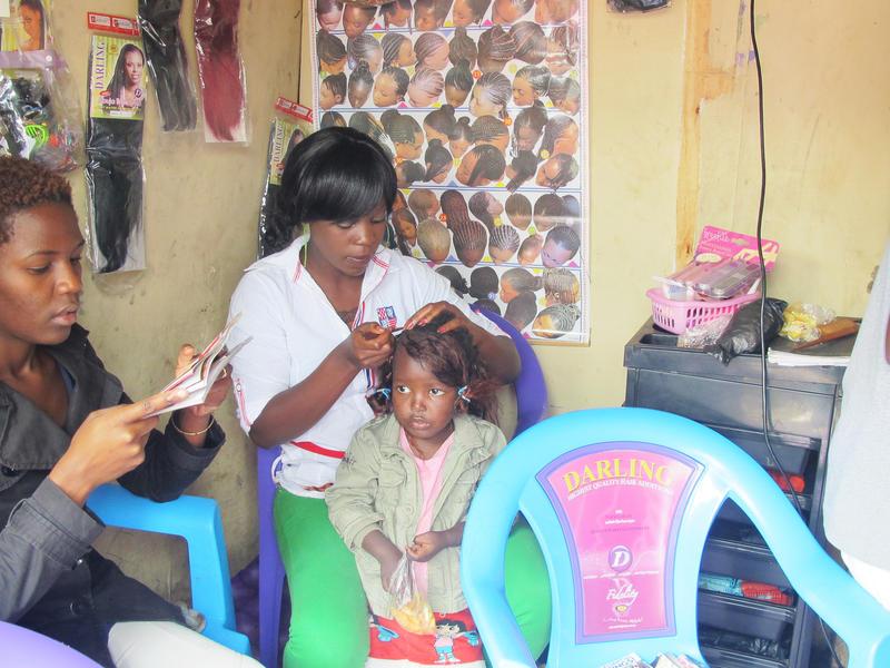 Susan braids a girl's hair