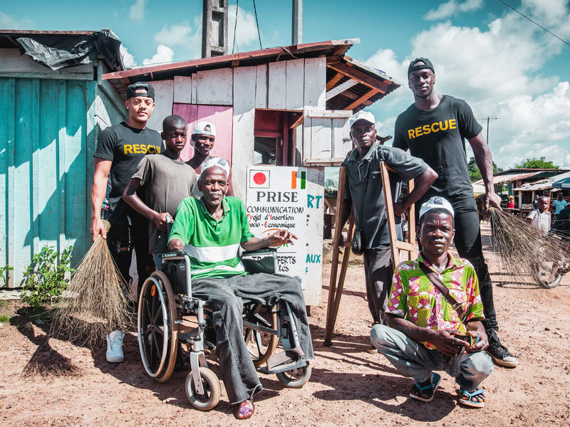 Nico & Vinz with three Ivorian men living with with disabilities