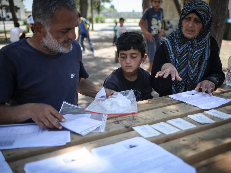 Family prepare their relocation application to Germany