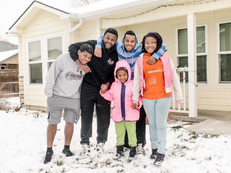The Ngalamulume siblings in front of their home in Boise, Idaho.