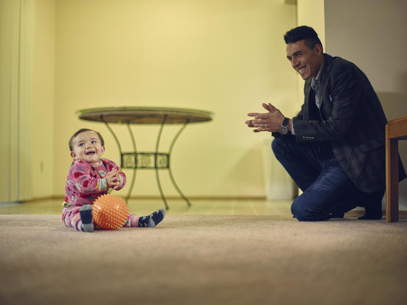 Adil with his son Steven inside their apartment
