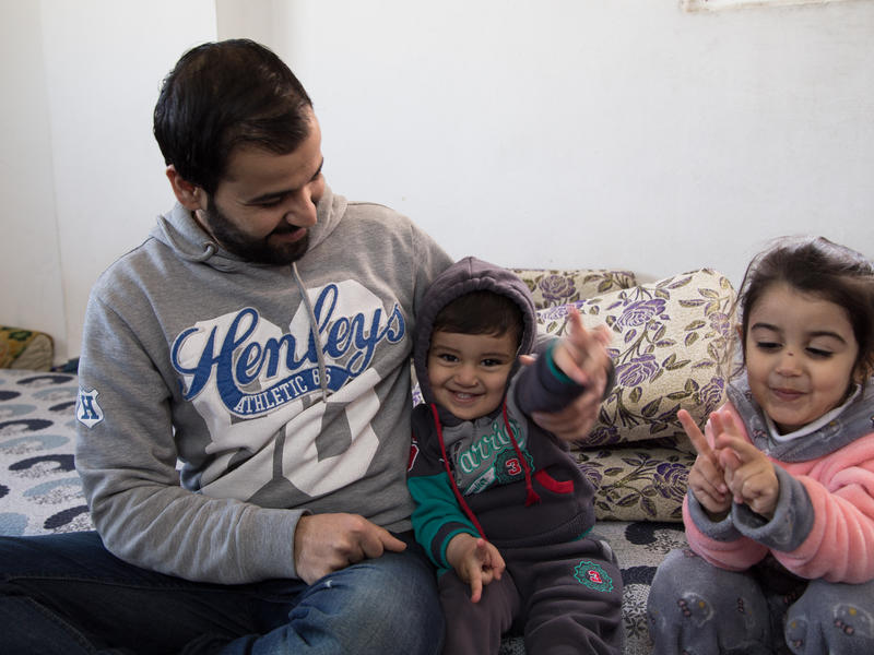 Mohammed with his son Khaled in their home in Irbid, Jordan