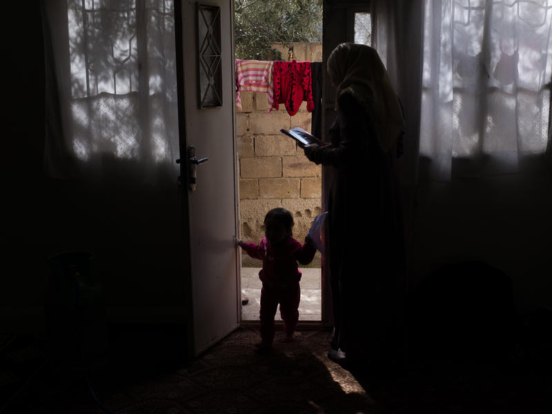 Syrian refugee woman at her home in Jordan