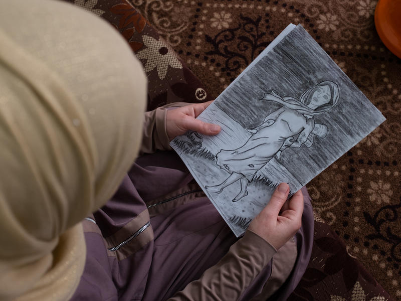 Syrian woman with a drawing
