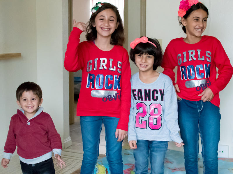 Two-year-old Khaled along with his older sisters Rouaa, Rayan and Raghad at their home in San Diego.