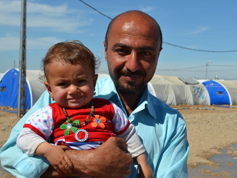 Omar and his baby daughter Amira fled to the Hammam al Alil displacement camp