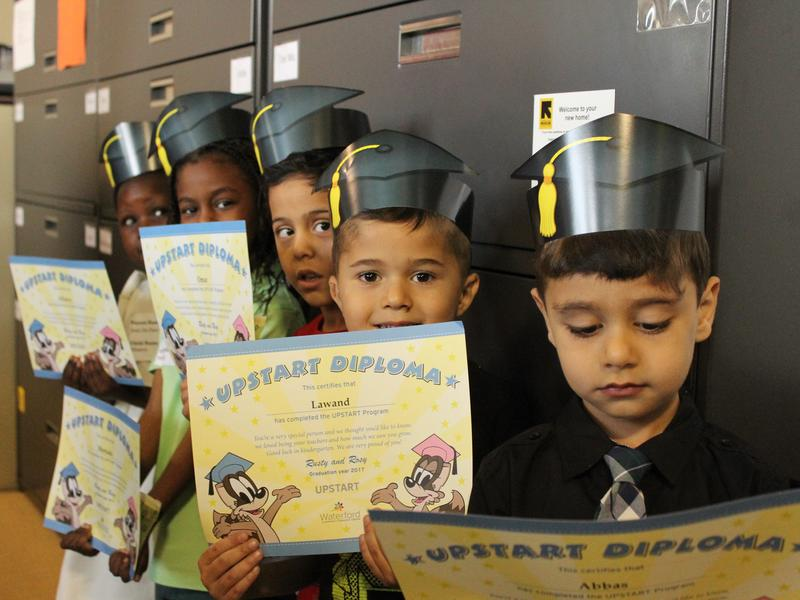 Four-year-olds lined up waiting to be announced during the UPSTART graduation