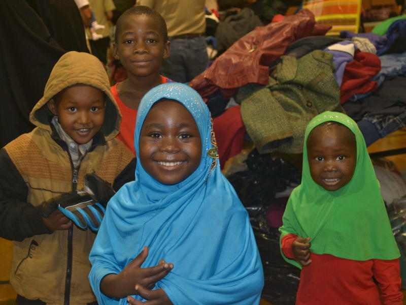 Four refugee children pick out winter clothing items at the 2016 Winter Clothing Drive in Salt Lake City