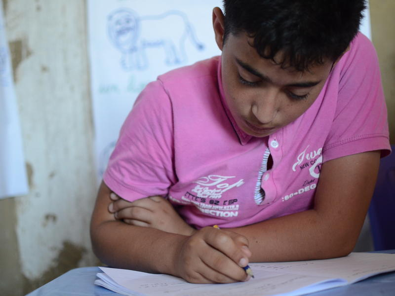 13-year-old Mahmoud attends an IRC supportive class in Lebanon