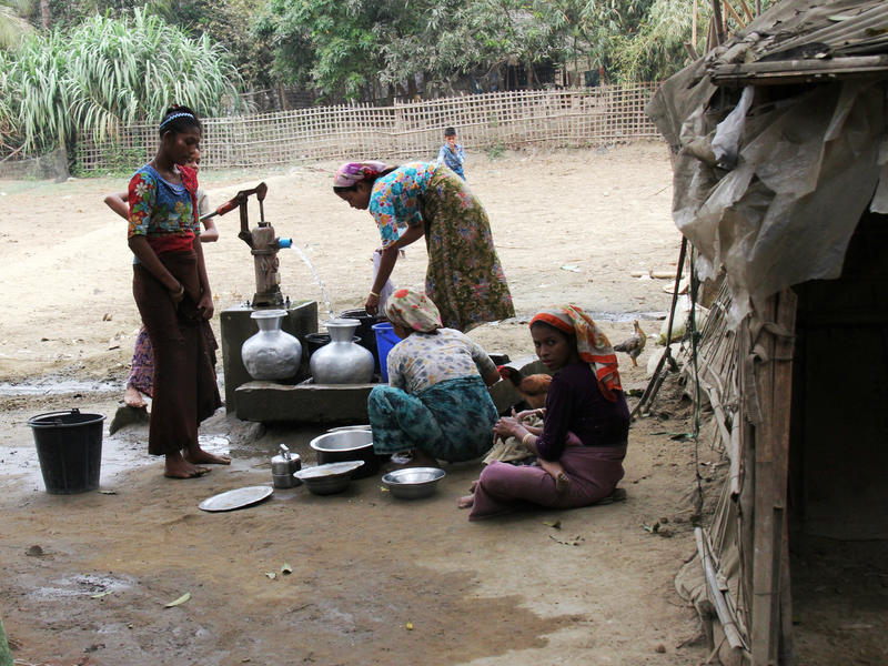 Women pump water at a camp in Sittwe, Myanmar