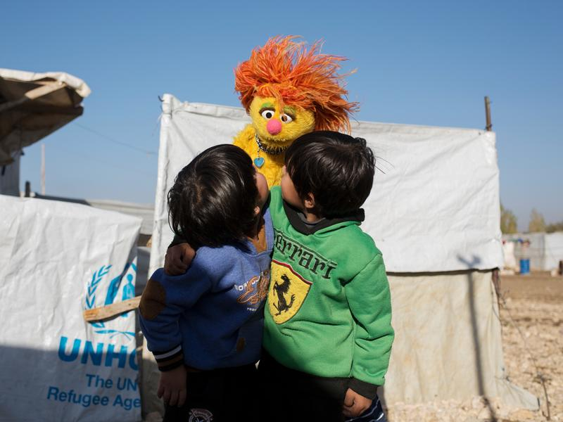 Syrian boys play with Sesame Street Muppet Tonton