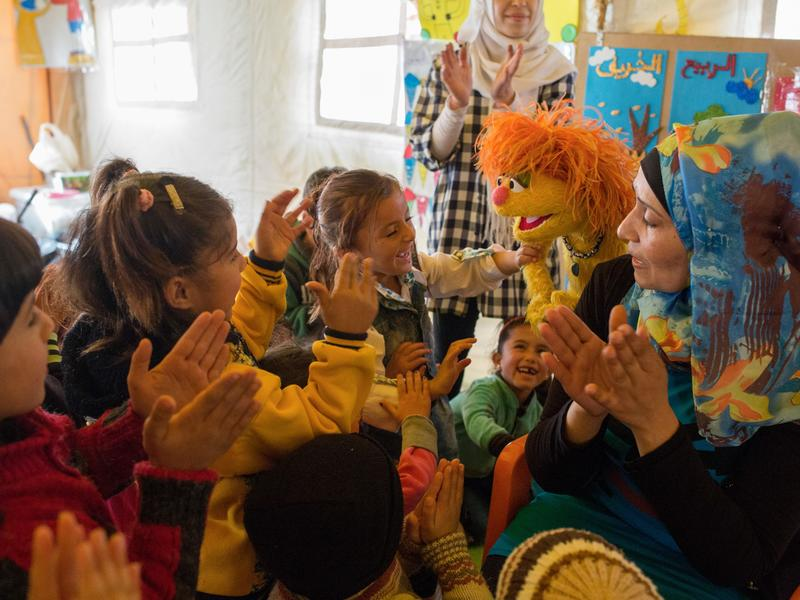 Syrian children with Sesame Street Muppet Tonton