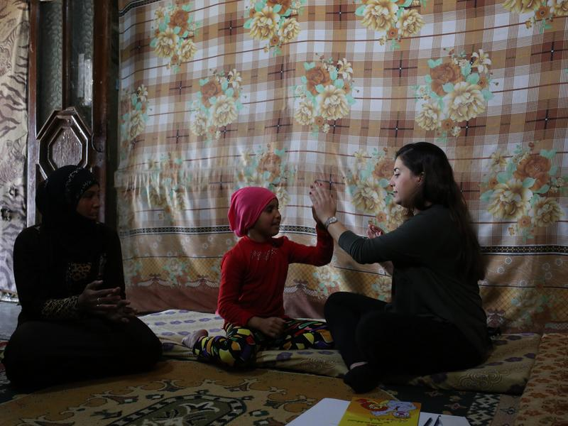 IRC aid worker with Syrian family