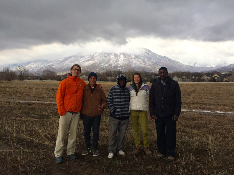 International Rescue Committee in Salt Lake City's New Roots program staff stand with refugee farmers at the newly expanded farm site.
