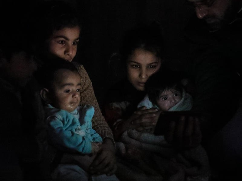 Young girls soothe babies sheltering underground in Eastern Ghouta.