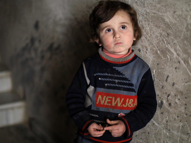 Syrian boy in underground bunker by the stairs