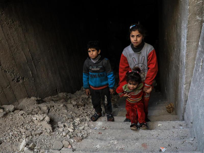 Syrian children climb from their underground bunker in Eastern Ghouta