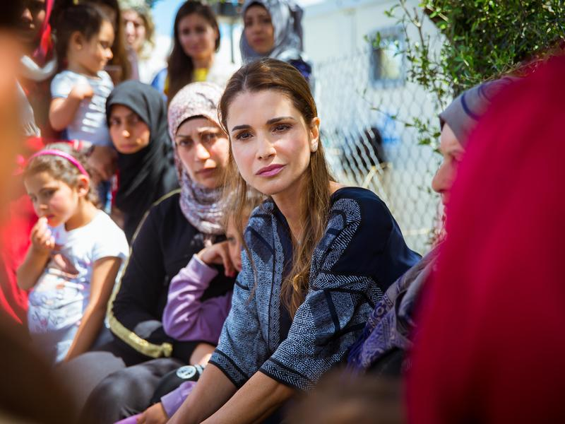 Queen Rania Al Abdullah of Jordan listens to refugee women at a refugee camp in Greece