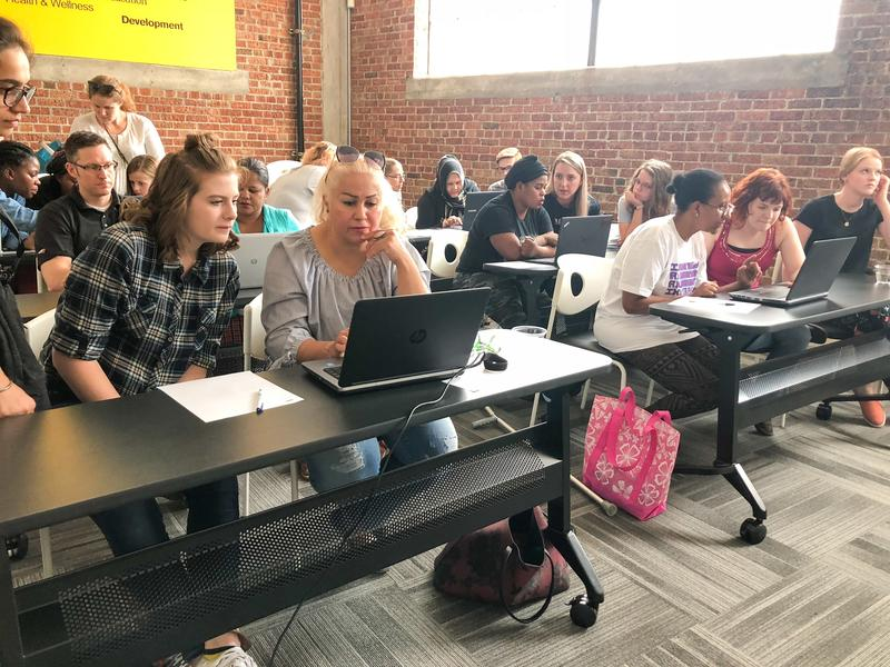 Refugee women and Pluralsight volunteers participate in Tech Workshop at the International Rescue Committee in Salt Lake City
