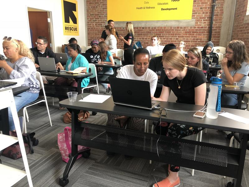 Refugee women and Pluralsight volunteers participate in the All-Women Tech Workshop at the International Rescue Committee in Salt Lake City