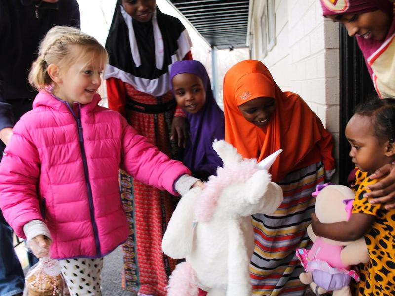 Light One Candle at the International Rescue Committee brings the community together--a young girl and her family raised funds to fulfill the holiday wish list of a refugee family.