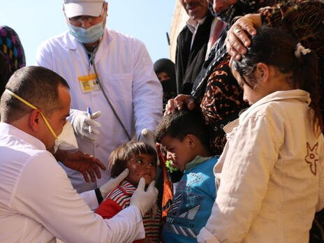 Health workers treat displaced children in northeastern Syria
