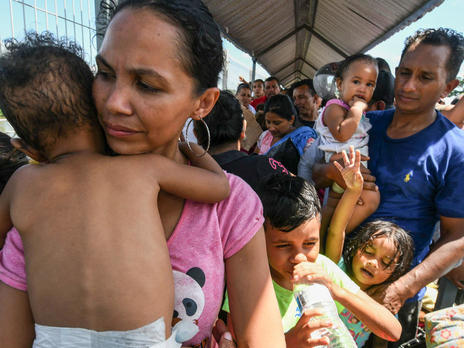A family travels to the U.S.-Mexico border in a caravan of people fleeing violence inCentral America