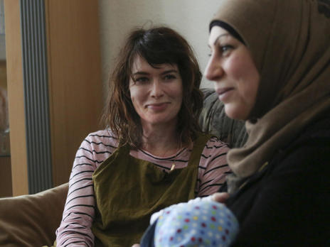 Lena Headey with Marwa, a refugee starting over in Germany