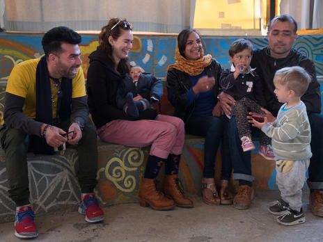 Lena Headey with refugee families in Lesbos, Greece