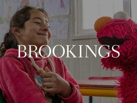 Sesame Street Muppet Elmo and a Syrian refugee girl, part of Sesame Workshop and the IRC's Ahlan Simsim early education program for refugees