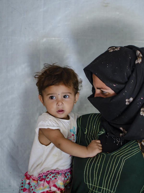 Syrian mother and refugee with her daughter in Lebanon