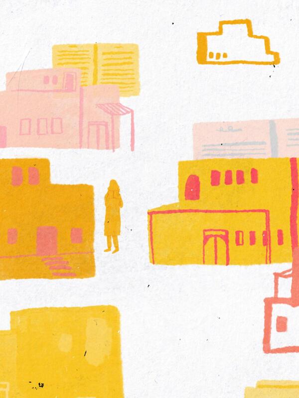 One Afghan girl walks between buildings