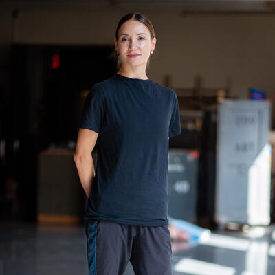 Christive Shevchenko stands in a studio in her rehearsal clothes for a World Refugee Day 2021 photo shoot.