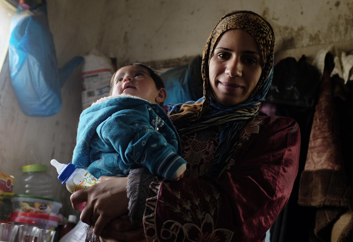 A Syrian woman with her child living in Jordan
