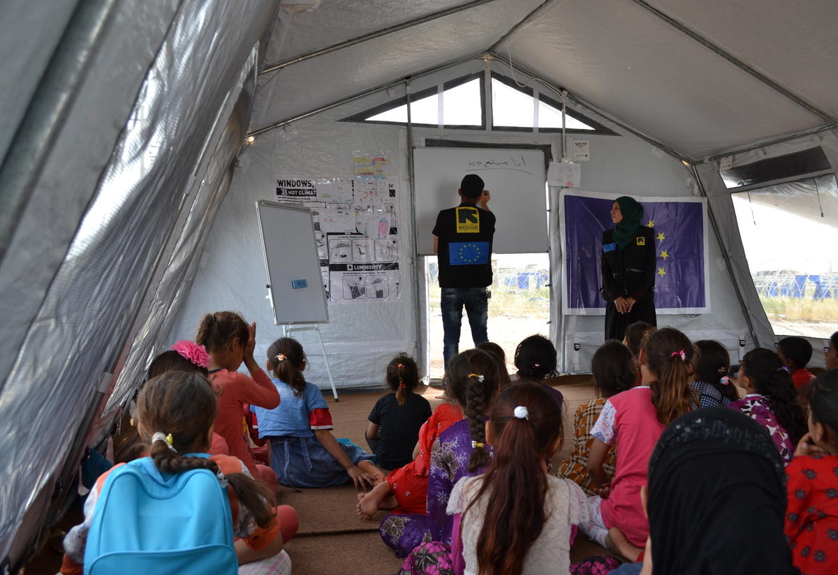 Two IRC aid workers lead a class in the tent that serves as a safe healing and learning space in Nargazilia camp.