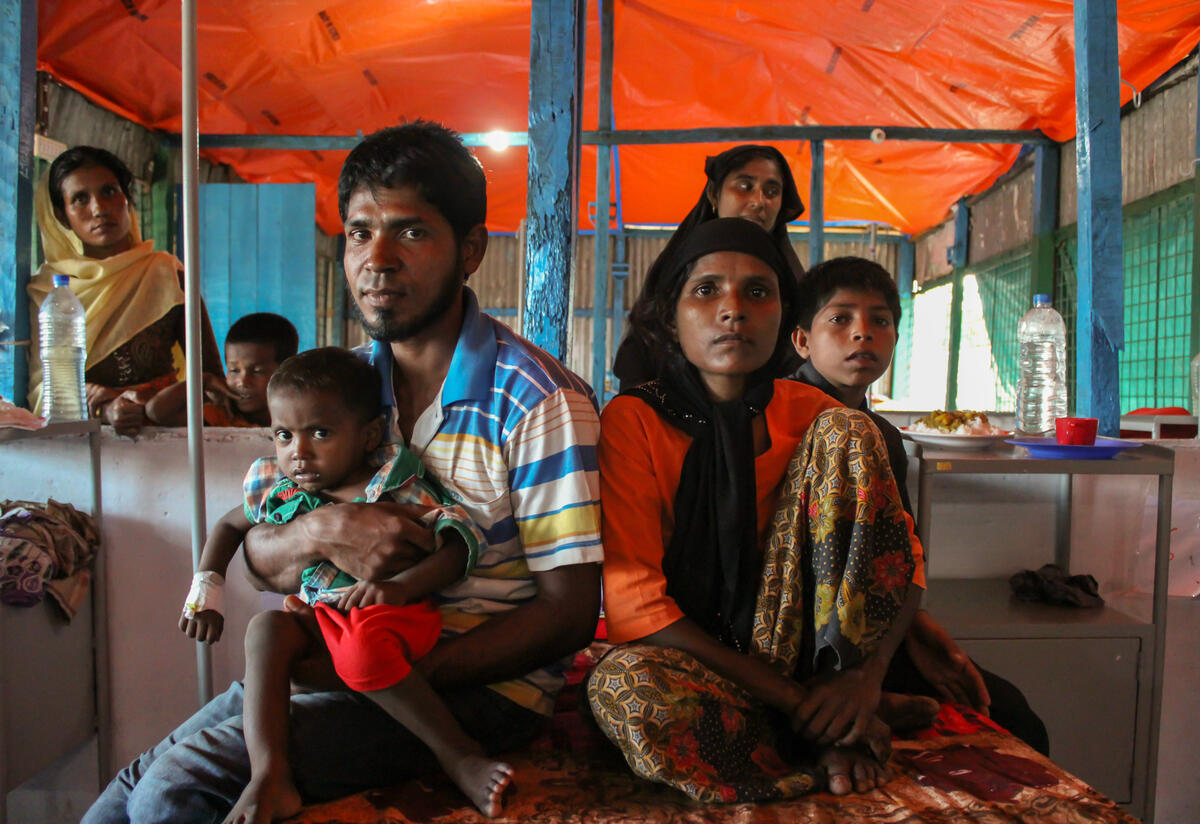 A Rohingya refugee family at an IRC-supported health Facility in Cox's Bazar, Bangladesh.