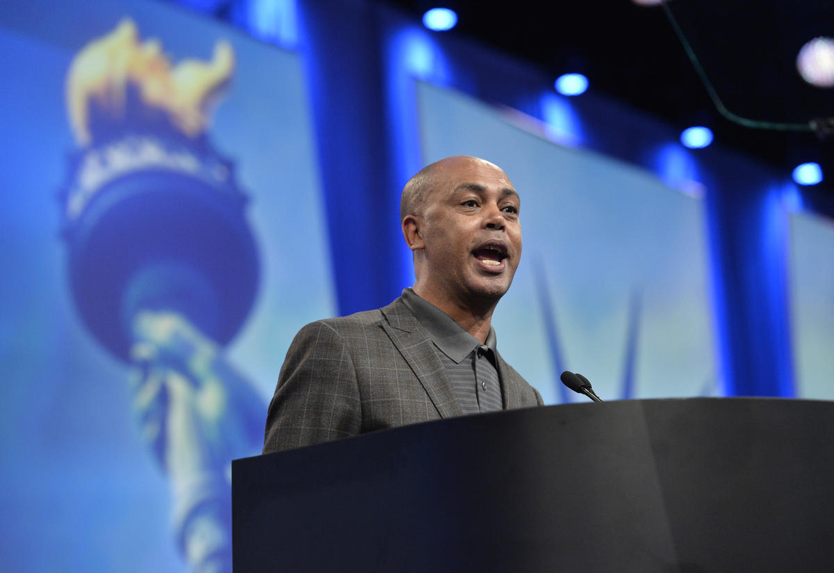 Tefere Gebre at the podium speaking at an AFL-CIO event