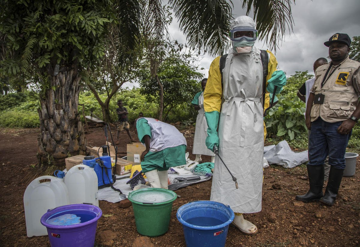Health workers get dressed in full personal protective gear
