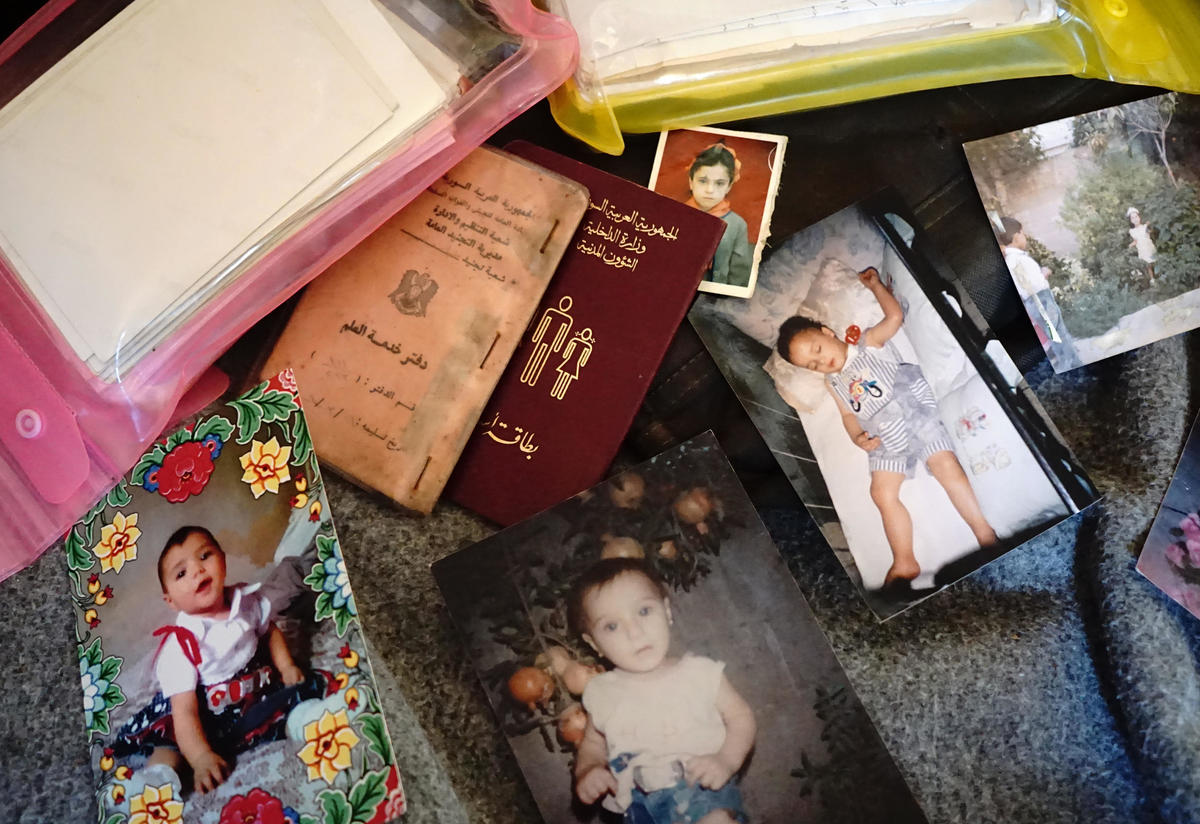 IDs and family photos brought by asylum seekers to Greece