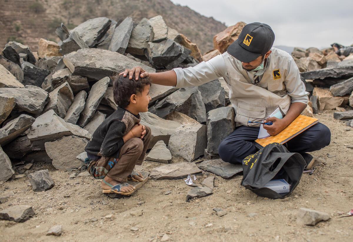 An IRC health worker examines a child in the mountain village of Okiba, Yemen