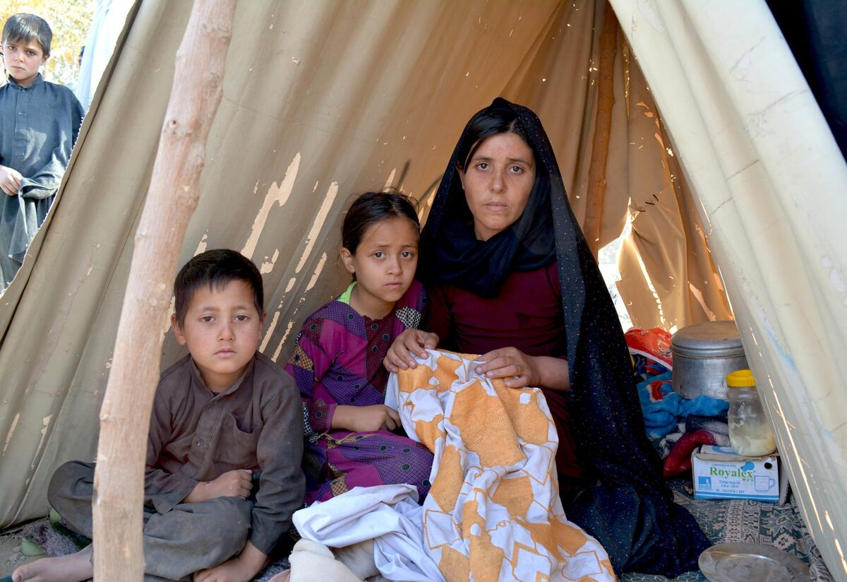 Zainab, 23, in a tent with her two children