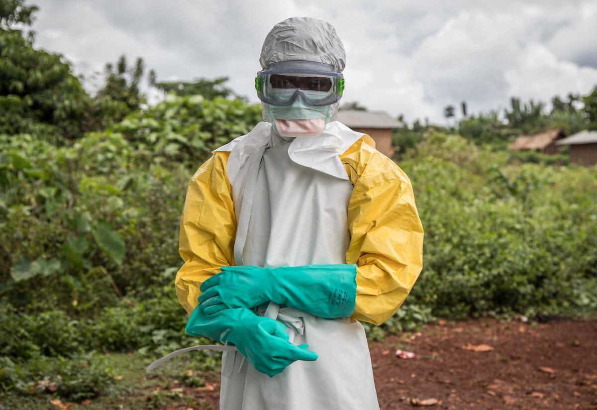 A health worker is dressed in full personal protective equipment to disinfect Case Du Salut health facility in Mabalako, North Kivu, Democratic Republic of Congo