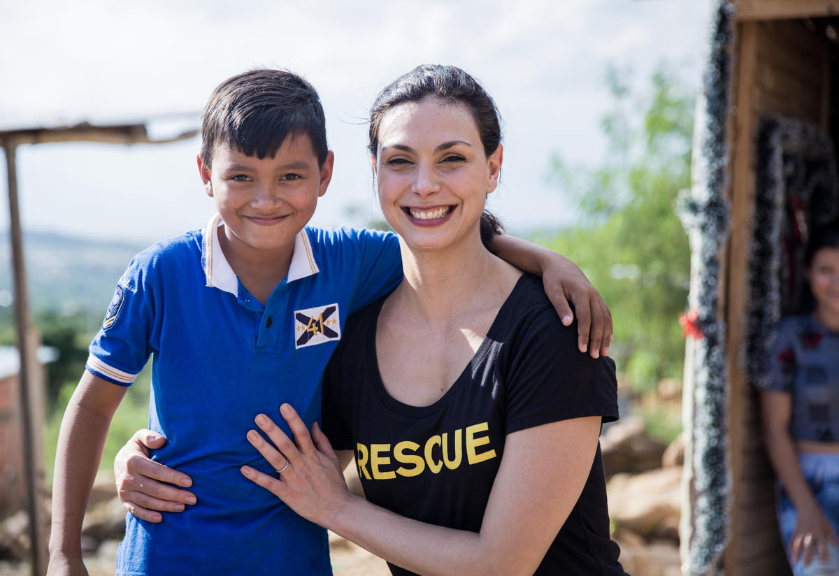 Morena Baccarin with a young Venezuelan refugee living with his family in the Colombian border city of Cúcuta.